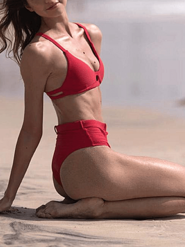top escort model in red bikini on the beach