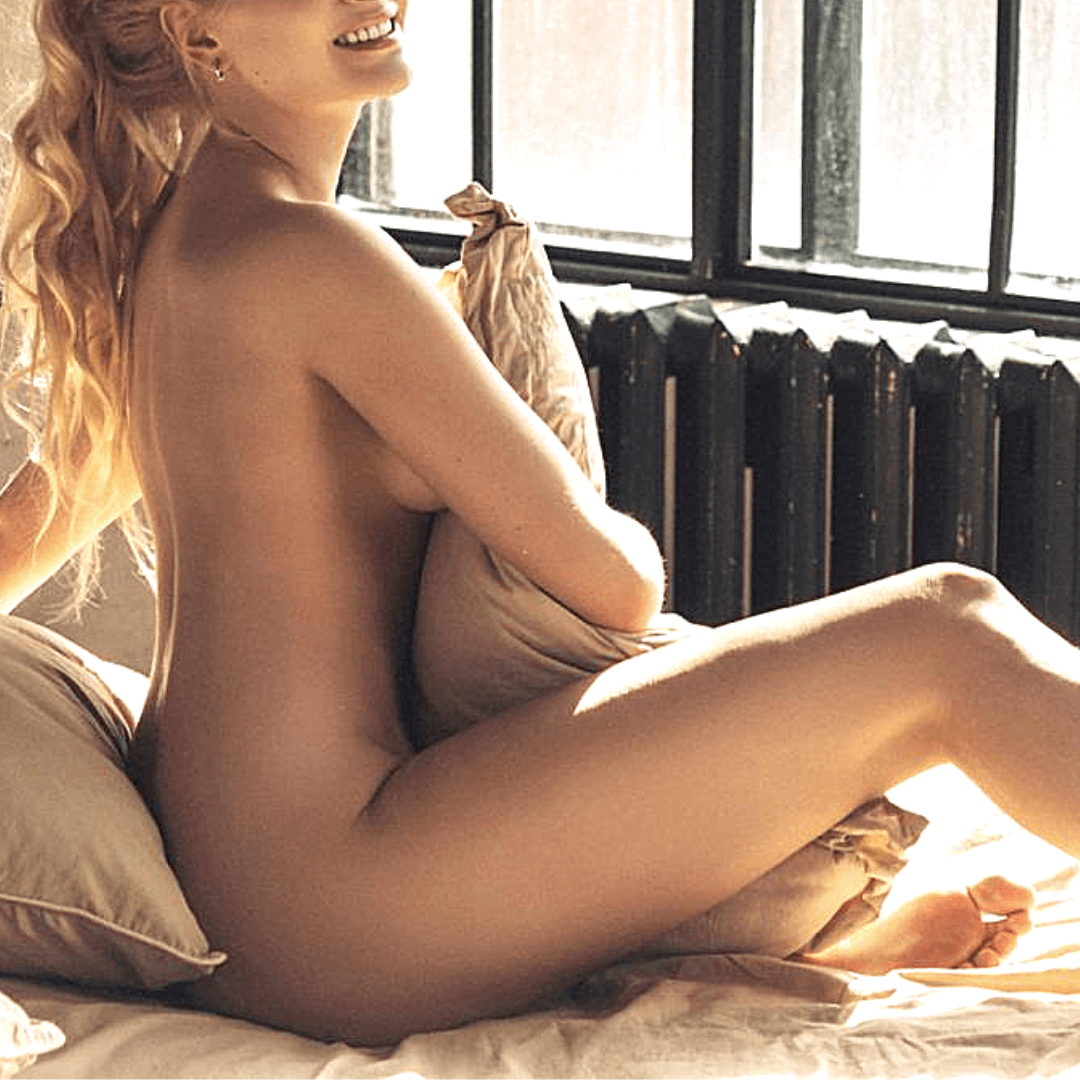 young escort model playing in the bed