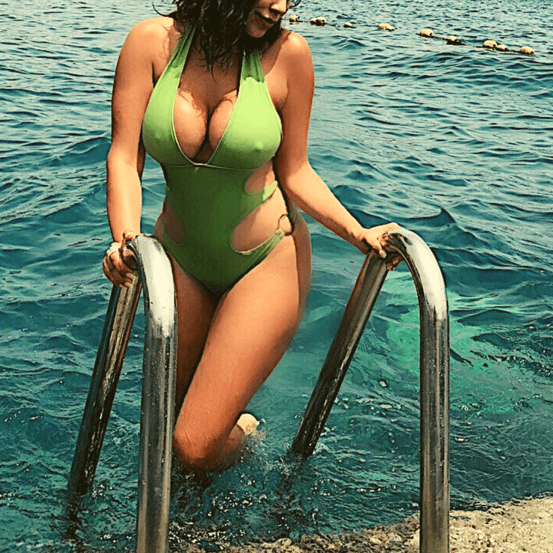 laura in a green sexy badingsuit