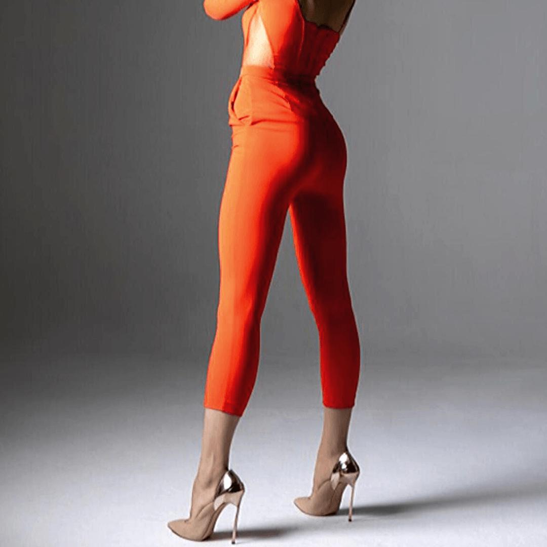 Elena in an orange catsuit